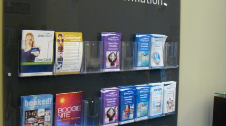 Clear 5mm Acrylic with flood vinyl to reverse, cut vinyl to face & literature holders mounted to face